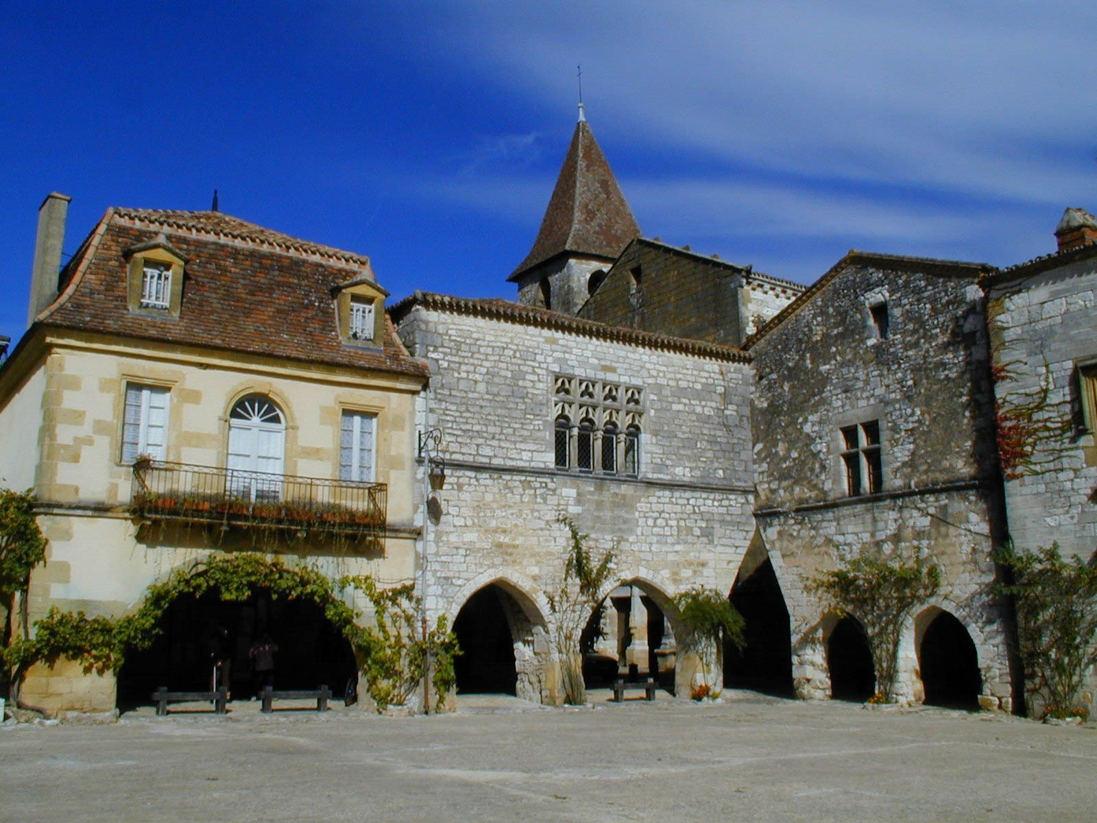 The beautiful main square of the 13th Century Bastide village of Monpazier in the Dordogne Region of France