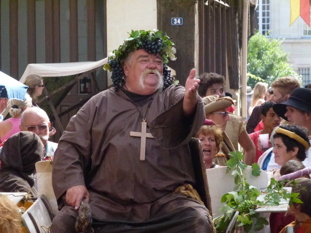 Bacchus singing the praises of good wine at the Medieval Festival held in Chinon in th Loire Valley of France every year in August