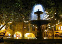 The Place Aux Herbes Fountain at Night in Uzès, Provence.